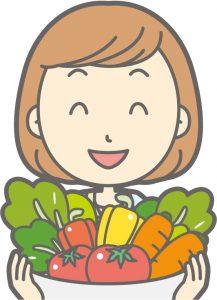 野菜を手にする女性